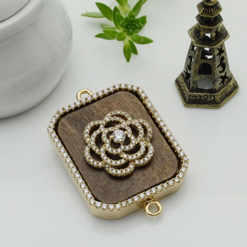 Elemento oro con due anelli zirconi fiore piastra legno antico ideare centro collana