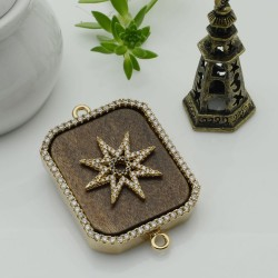 Elemento oro con due anelli zirconi stella piastra legno antico ideare centro collana