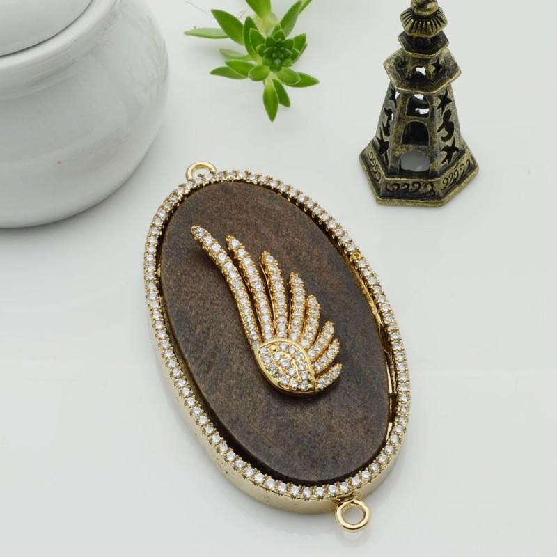 Elemento ovale oro con due anelli zirconi ali piastra legno antico ideare centro collana