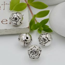 Distanziatori Perline tondo con fantasia a fiori 9 mm 4 pz in metallo per bigiotteria per le tue creazioni!
