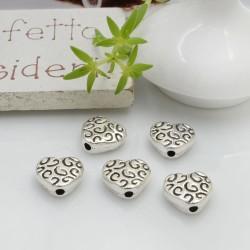 Distanziatori Perline piatto colore argento 9 mm 8 pz a forma di cuore con fantasia in metallo per le tue creazioni!