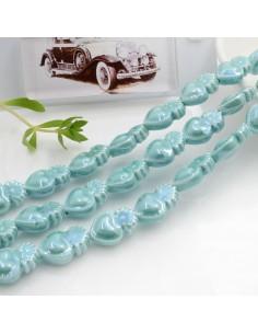 Filo perle a forma di cuore sacro in ceramica luminosa e smaltata colore tiffany 16 x 10 mm 20 pz per le tue creazioni!!