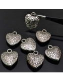 ciondoli cuore con fantasia 18x20mm 7pz in argentone per bigiotteria
